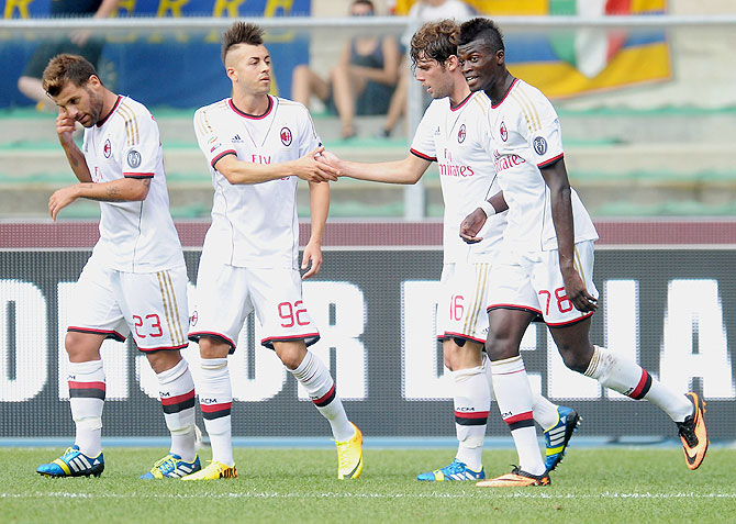 Andrea Poli of AC Milan celebrates with teammates after scoring against Hellas Verona FC during their Serie A match on Saturday