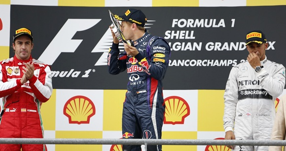 Red Bull Formula One driver Sebastian Vettel of Germany (centre) celebrates