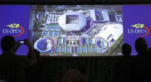 Journalists watch a video showing an artist's concept of the proposed overhaul to the United States Tennis Association (USTA) Billie Jean King National Tennis Center