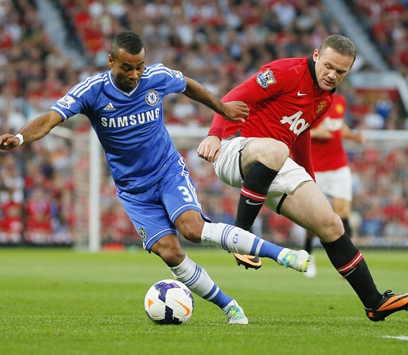 Manchester United's Wayne Rooney (right) challenges Chelsea's Ashley Cole