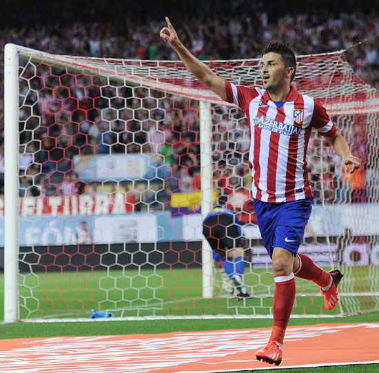 David Villa of Atletico de Madrid celebrates after scoring his team's opening goal during the Spanish Super Cup first leg match against Barcelona