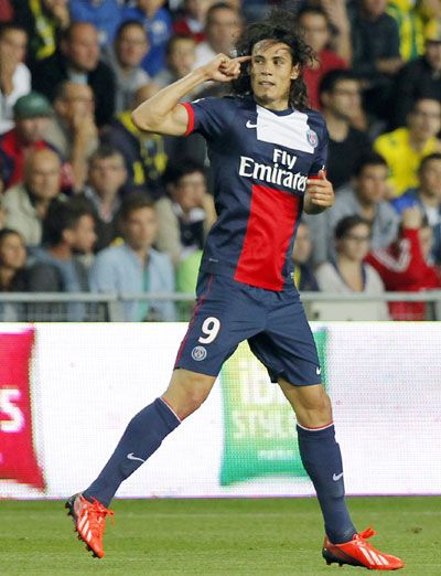 Paris Saint-Germain's Edinson Cavani celebrates after scoring against Nantes