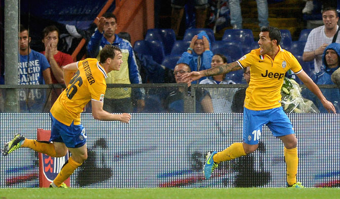 Carlos Tevez of Juventus (right) celebrates scoring the first goal during the Serie A match against Sampdoria