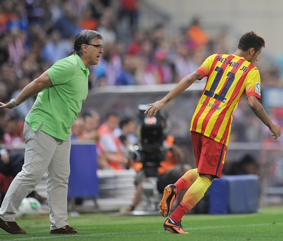 Neymar of Barcelona celebrates with head coach Gerardo 'Tata' Martino