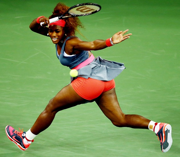Serena Williams of the plays a forehand against Francesca Schiavone