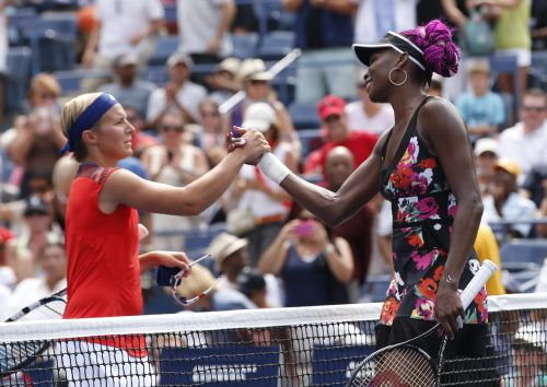 Venus Williams of the US is congratulated by Kirsten Flipkens of Belgium (L) after Williams won their match