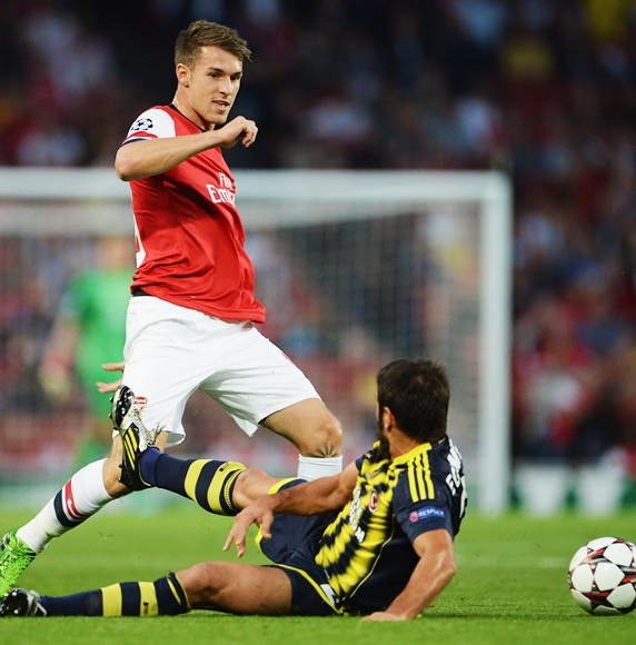 Aaron Ramsey of Arsenal is challenged by Egemen Korkmaz of Fenerbahce