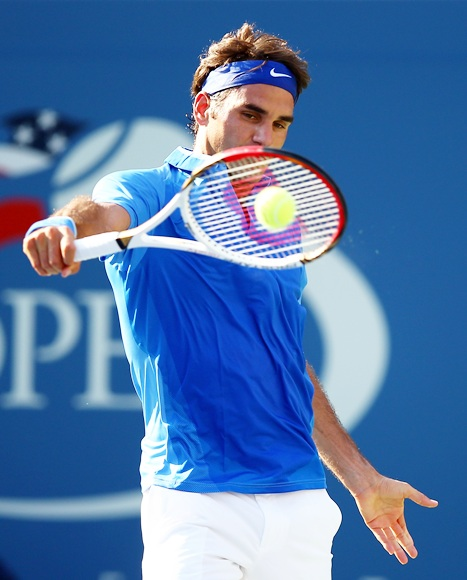 Roger Federer of Switzerland returns a shot