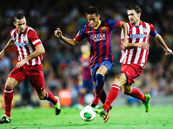 Neymar (centre) of FC Barcelona duels for the ball with Mario Suarez (right) and Gabi Fernandez of Atletico de Madrid