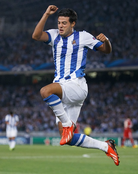 Carlos Vela of Real Sociedad jumps while celebrating scoring