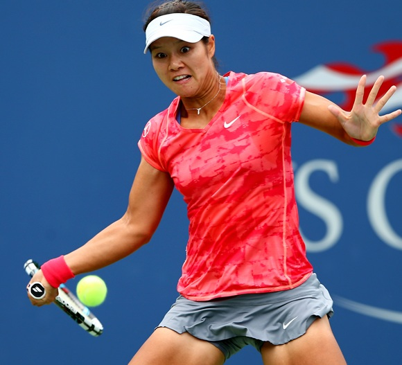 Na Li of China returns a shot