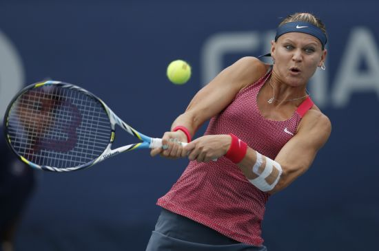 Lucie Safarova of the Czech Republic hits a return to Roberta Vinci of Italy at the U.S. Open