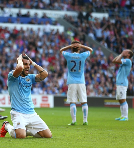 Alvaro Negredo of Manchester City and teammates react
