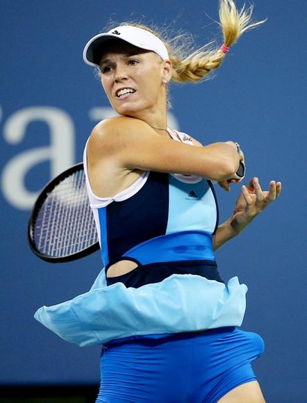 Caroline Wozniacki of Denmark plays a forehand