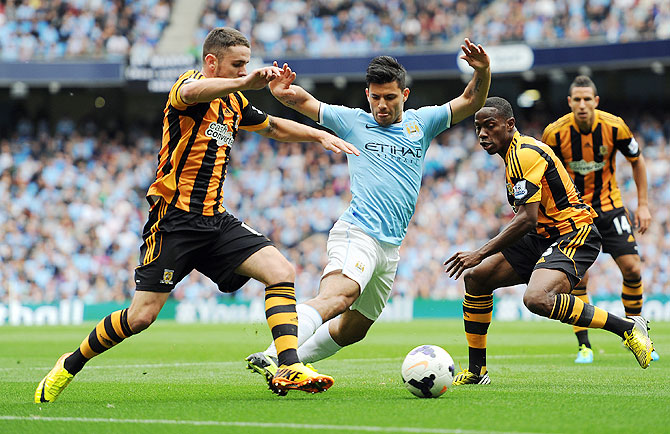 Manchester City Sergio Aguero (centre) is challenged by Hull City's Maynor Figueroa (right) and Robbie Brady during their English Premier League match on Saturday