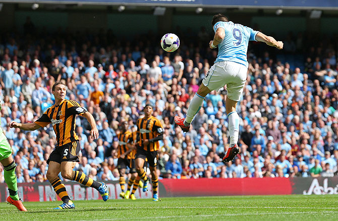 Manchester City's Alvaro Negredo heads in to score the opening goal against Hull City on Saturday