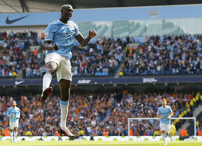 Manchester City's Yaya Toure celebrates after scoring the second goal against Hull City on Saturday