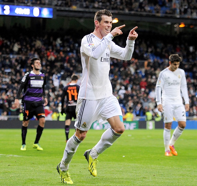 Gareth Bale of Real Madrid CF celebrates after scoring Real's 4th goal and his hat-trick