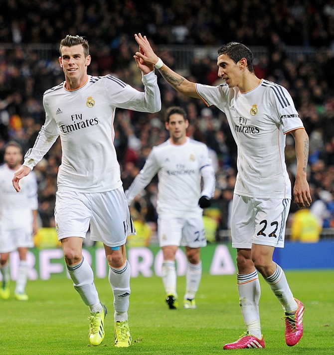 Gareth Bale of Real Madrid CF celebrates with Angel Di Maria