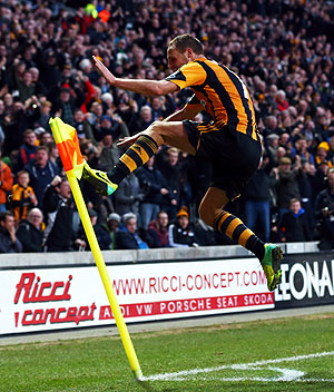David Meyler of Hull City celebrates scoring his team's second goal against Liverpool during their English Premier League match at KC Stadium in Hull, England on Sunday