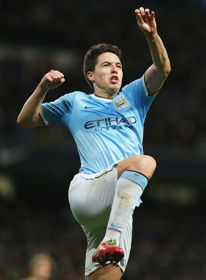 Samir Nasri of Manchester City celebrates his team's third goal against Swansea City