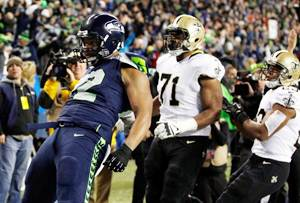 Defensive end Michael Bennett #72 of the Seattle Seahawks celebrates a first quarter touchdown