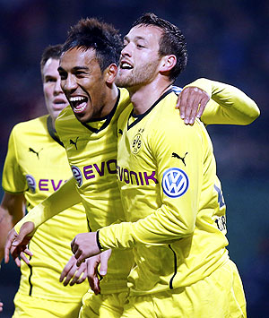 Julian Schieber (right) and Aubameyang (centre) of Borussia Dortmund celebrate Schieber's goal against third division club FC. Saarbruecken