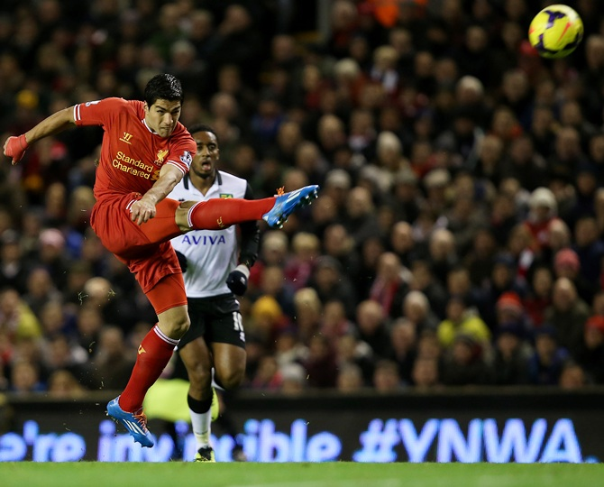 Luis Suarez of Liverpool scores his first goal