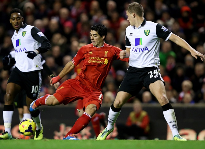 Luis Suarez of Liverpool scores