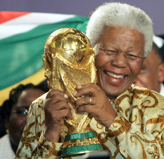 Former South African President Nelson Mandela holds the World Cup Trophy after FIFA President Joseph Blatter announced that South Africa is chosen to host the 2010 Soccer World Cup