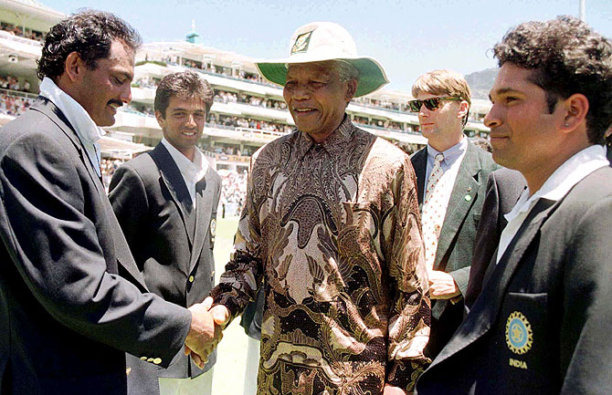 South African President Nelson Mandela (centre) is introduced to Mohammad Azharudin (left) by the Indian captain Sachin Tendulkar (right) on January 4, 1997 at the Newlands cricket ground