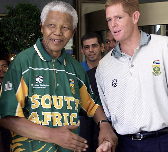Former South African president Nelson Mandela (left) with Shaun Pollock
