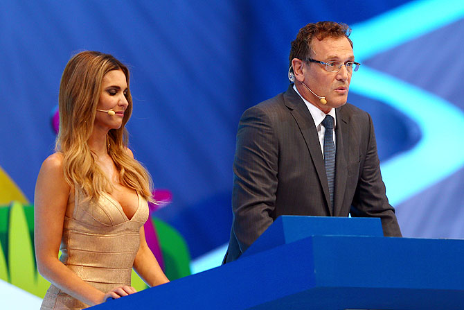 Host Fernanda Lima and FIFA Secretary General Jerome Valcke speak to the audience before the draw announcement on Friday