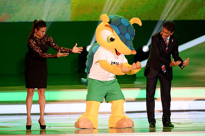 Bebeto performs his famous goal celebration with Marta and the official mascot, Fuleco on Friday