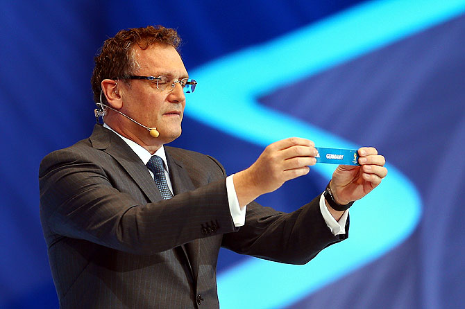 FIFA Secretary General Jerome Valcke holds up the name of Germany during the Final Draw on Friday