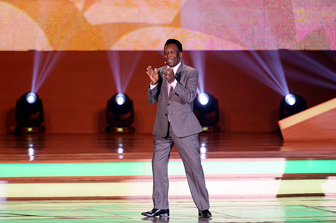 Pele applauds the audience before the draw on Friday