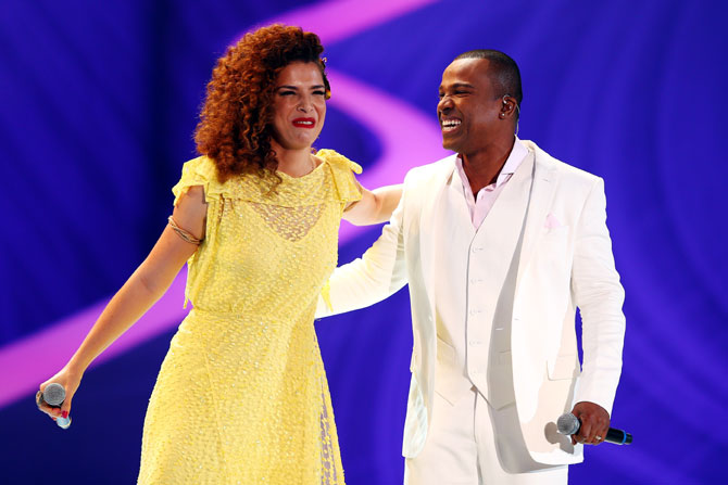 Vanessa da Mata and Alexandre Pires perform before the final draw announcement on Friday