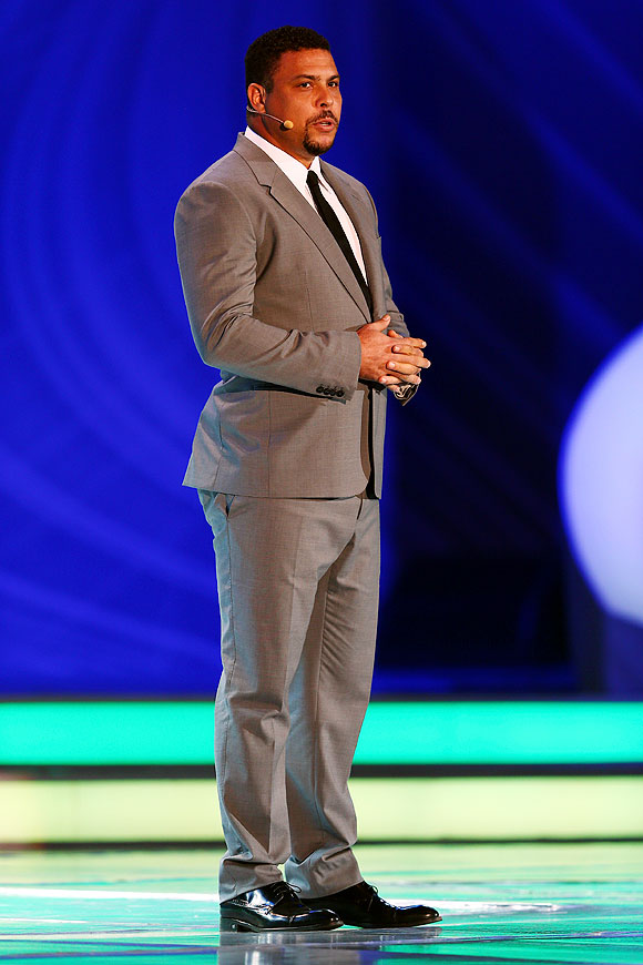 Ronaldo speaks to the audience on stage before the draw on Friday
