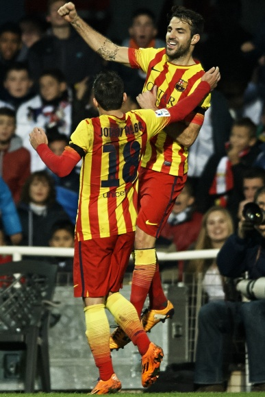 Cesc Fabregas (right) of Barcelona celebrates after scoring with his teammate Jordi Alba