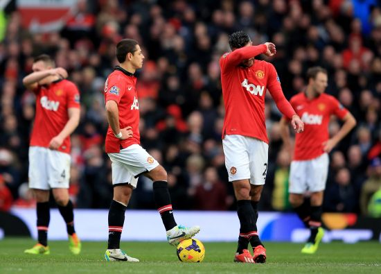 Manchestet United players react after conceding the goal