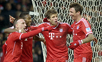 Bayern Munich's (L-R) Franck Ribery, David Alaba, Thomas Mueller and Mario Mandzukic celebrate after scoring against Werder Bremen on Saturday