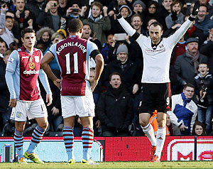 Fulham's Dimitar Berbatov (right) celebrates after scoring against Aston Villa during their English Premier League match at Craven Cottage in London, on Sunday