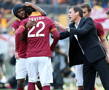 AS Roma's Mattia Destro #22 celebrates with Gervinho (left) and head coach Rudi Garcia after scoring the team's second goal against Fiorentina during their Serie A match at Stadio Olimpico on in Rome on Sunday