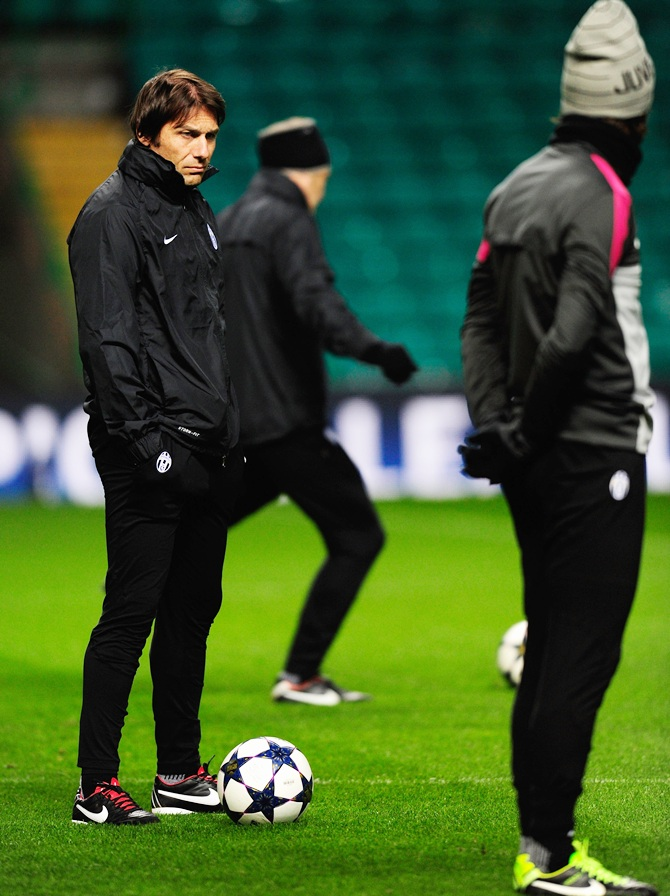 Juventus manager Antonio Conte (left) and Andrea Pirlo look on during training session