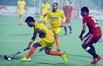 India's captain Manpreet Singh in thick of action during the match against Canada