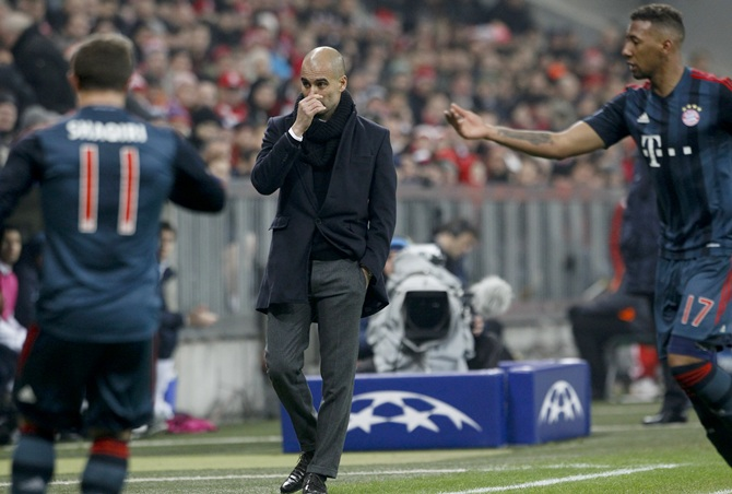Bayern Munich coach Pep Guardiola (centre) reacts