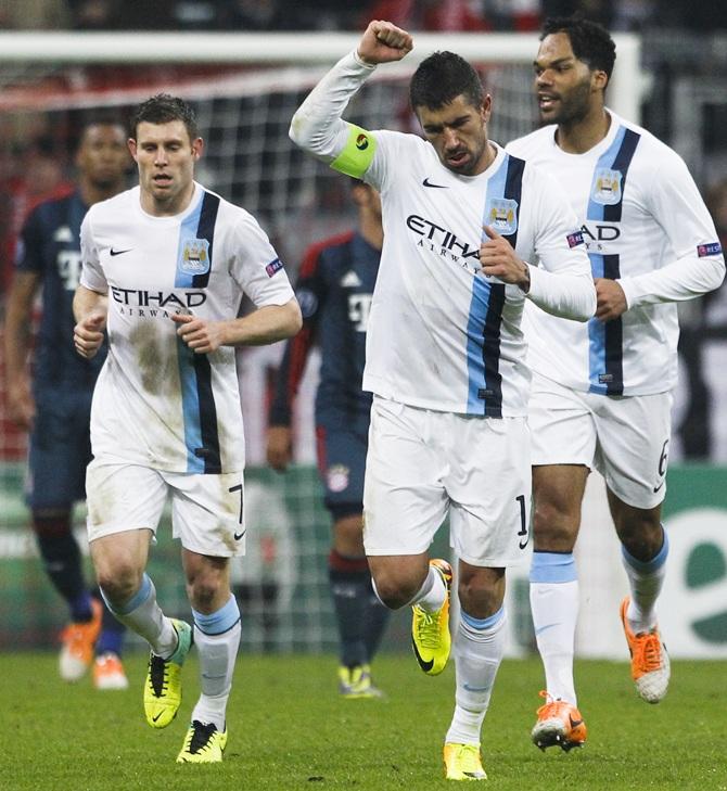 Manchester City's Aleksandar Kolarov (centre) celebrates with James Millner (left) and Joleon Lescott after scoring a goal