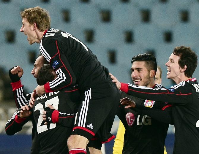 Bayer Leverkusen players celebrate a goal