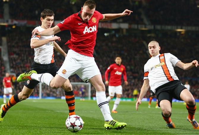 Phil Jones of Manchester United crosses the ball
