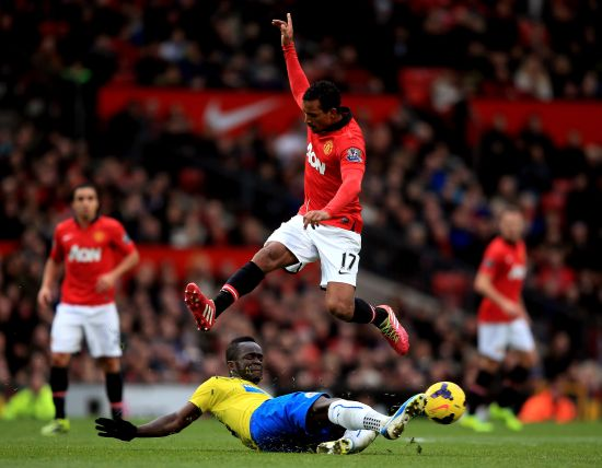 Nani of Manchester United hurrdles the tackle from Cheik Ismael Tiote of Newcastle